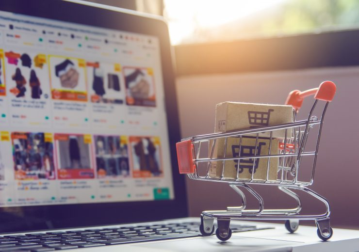 Shopping online concept - Parcel or Paper cartons with a shoppin